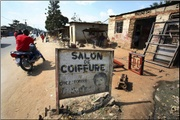 Sign at a salon in Kamenge, Burundi. Photo:Melanie Stetson Freeman